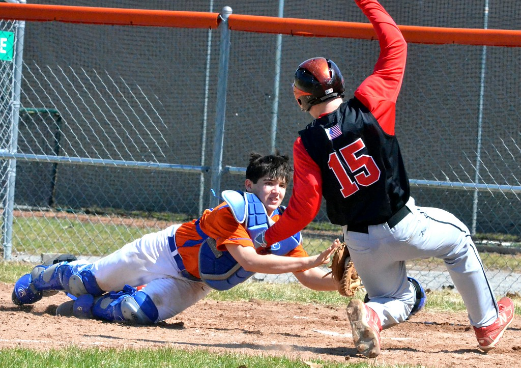 . KYLE MENNIG � ONEIDA DAILY DISPATCH Oneida catcher Jorden Barlow reaches back to tag Chittenango�s Mike Culkin (15) out at the plate during their game in Rome on Sunday, April 9, 2017.