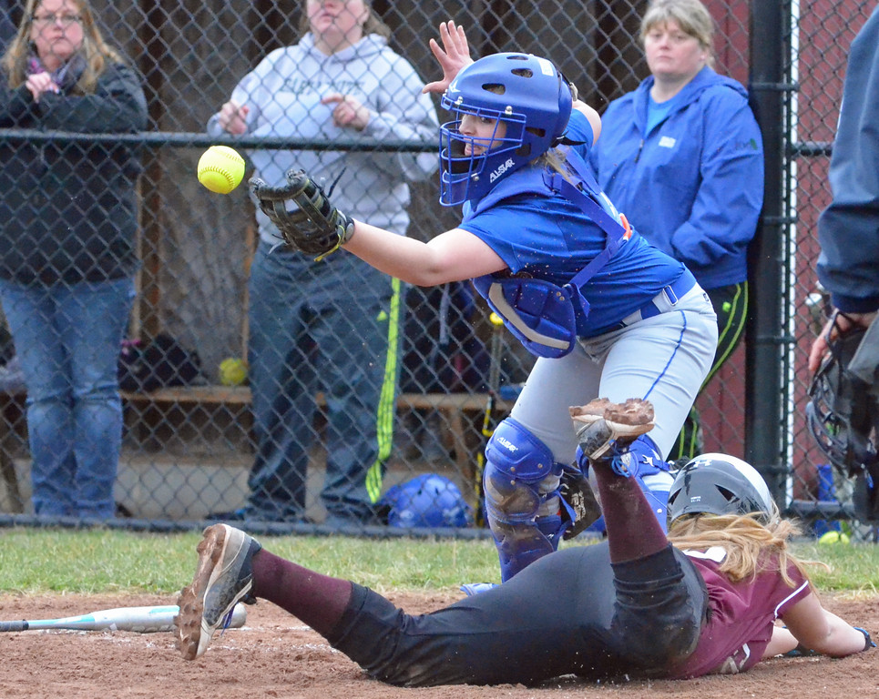. KYLE MENNIG - ONEIDA DAILY DISPATCH Stockbridge Valley\'s Kendra Webb (10) dives safely into home as Brookfield catcher Taylor Jaeger (4) handles the throw during their game in Munnsville on Wednesday, April 5, 2017.