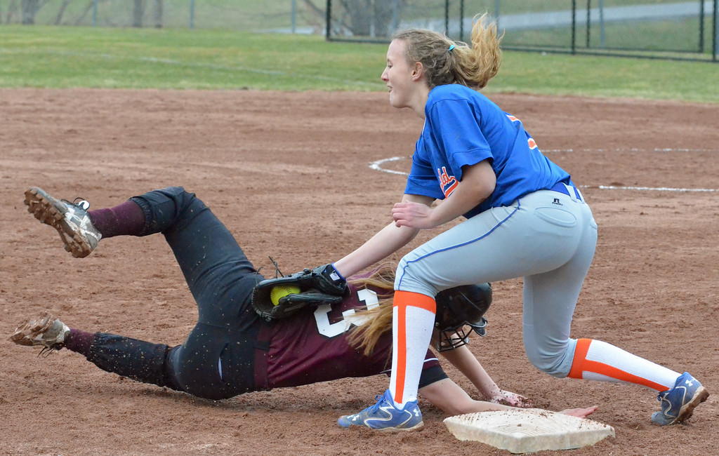 . KYLE MENNIG - ONEIDA DAILY DISPATCH Stockbridge Valley\'s Barbara Guinto (3) is tagged out at third by Brookfield\'s Madilyne Kupris (12) during their game in Munnsville on Wednesday, April 5, 2017.