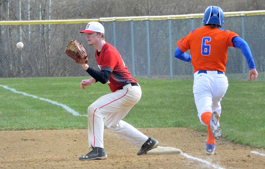 . KYLE MENNIG � ONEIDA DAILY DISPATCH Vernon-Verona-Sherrill\'s Davey Moffett (23) reaches to make the catch and retire Oneida\'s Henry Froass (6) at first during their game in Verona on Thursday, April 13, 2017.