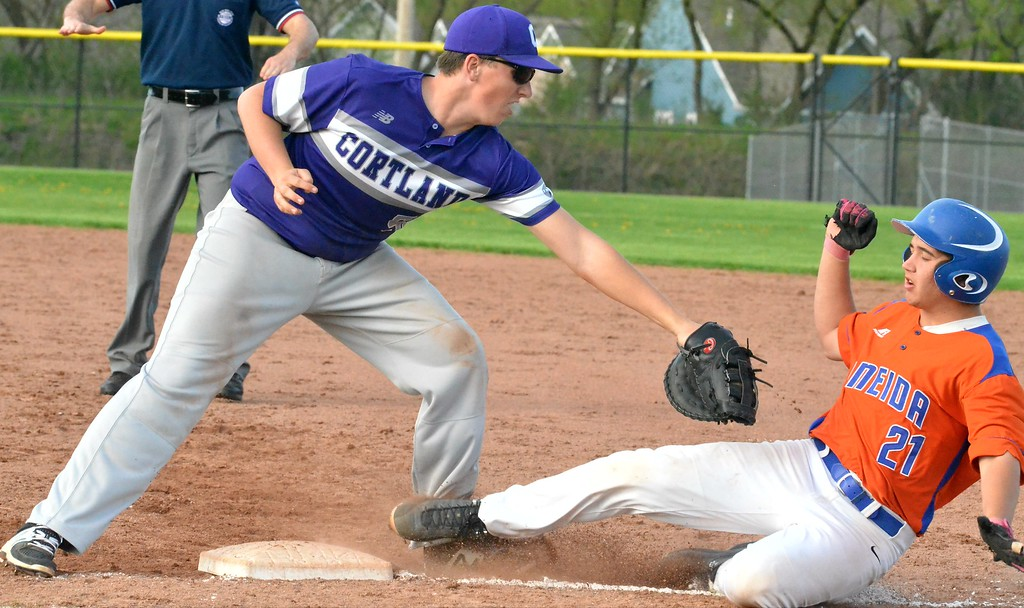 . KYLE MENNIG - ONEIDA DAILY DISPATCH Oneida\'s Jorden Barlow (21) slides safely back into second as Cortland\'s Steve Duff (52) reaches to make the tag during their game in Oneida on Friday, April 28, 2017.