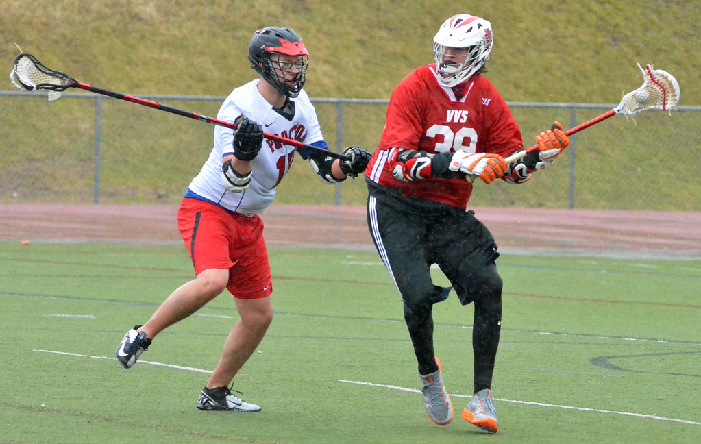 . KYLE MENNIG - ONEIDA DAILY DISPATCH Vernon-Verona-Sherrill\'s Richard Geiss prepares to deliver a pass as Proctor\'s Belmin Adic (15) defends during their game in Utica on Thursday, April 6, 2017.