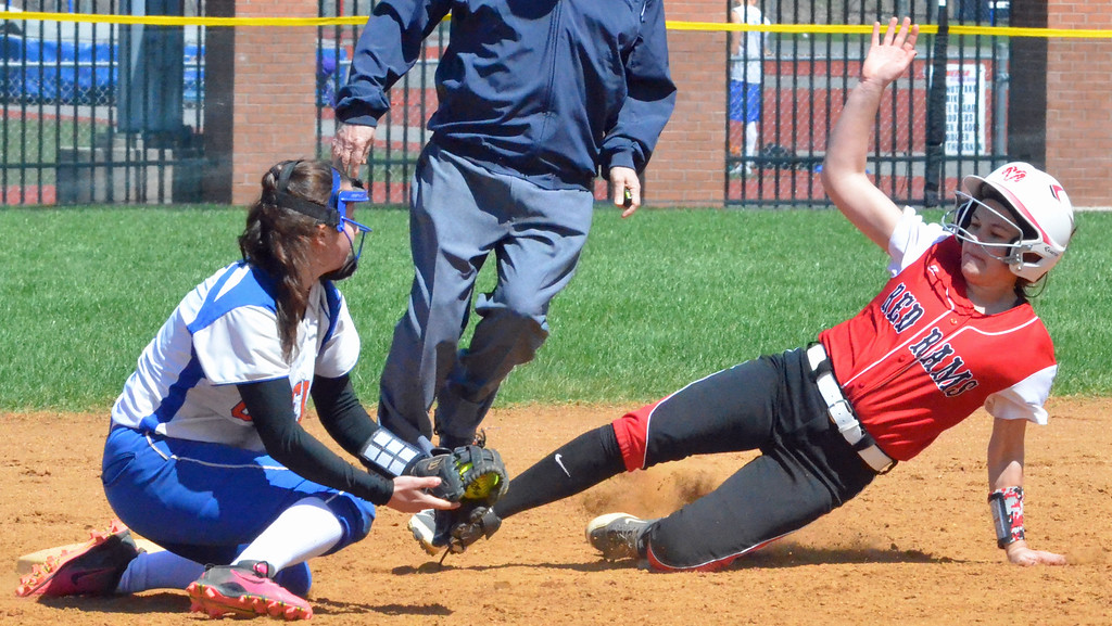 . KYLE MENNIG � ONEIDA DAILY DISPATCH Jamesville-DeWitt\'s Makenzie Keeler, right, goes to slide into second for a stolen base as Oneida\'s Brianna Laureti field\'s the throw during their game in Oneida on Monday, April 17, 2017. Skibitski was called out on the play.