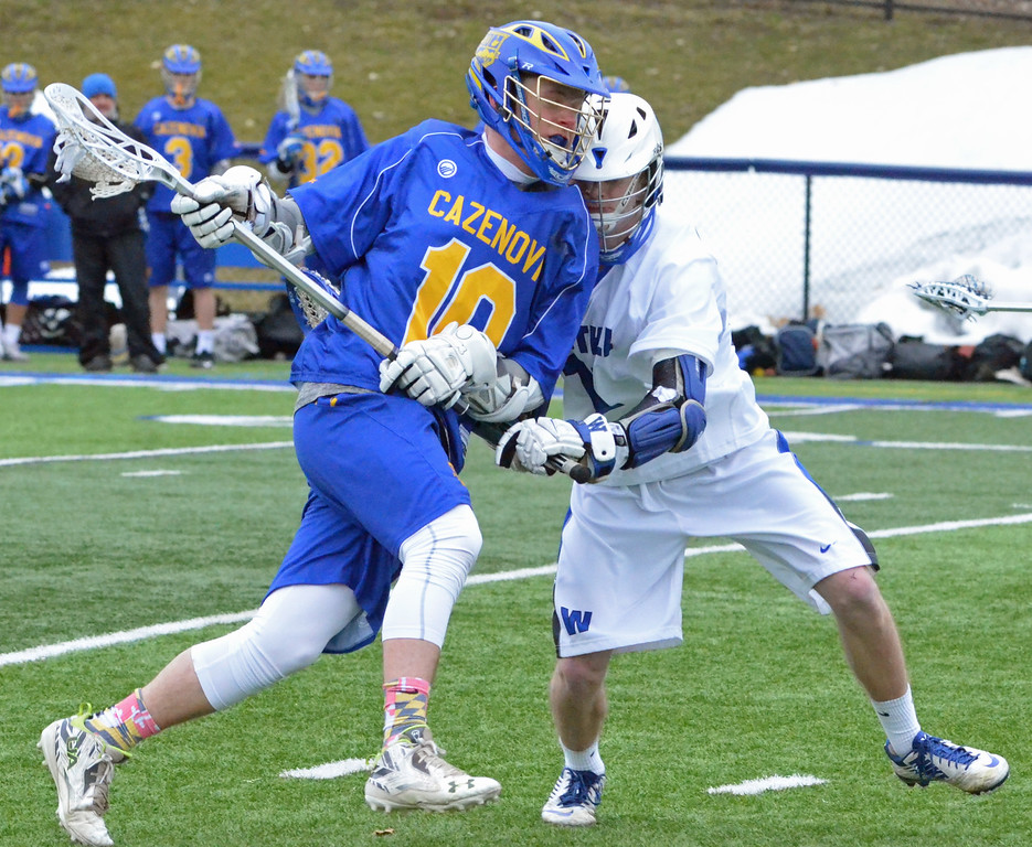. KYLE MENNIG - ONEIDA DAILY DISPATCH Cazenovia\'s Tim Burr (10) looks to attack as a Westhill player defends during their game in Syracuse on Saturday, April 1, 2017.