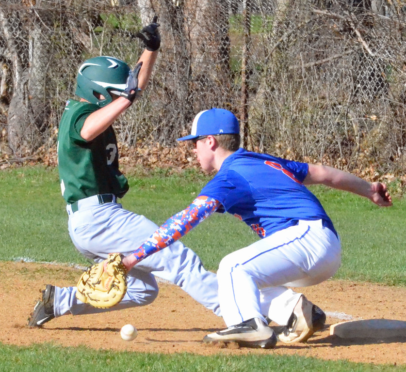 . KYLE MENNIG � ONEIDA DAILY DISPATCH Hamilton\'s Jacob Hill (3) slides back into first as New York Mills\' Rob Maciol (8) fields the throw during their game in Hamilton on Friday, April 14, 2017.