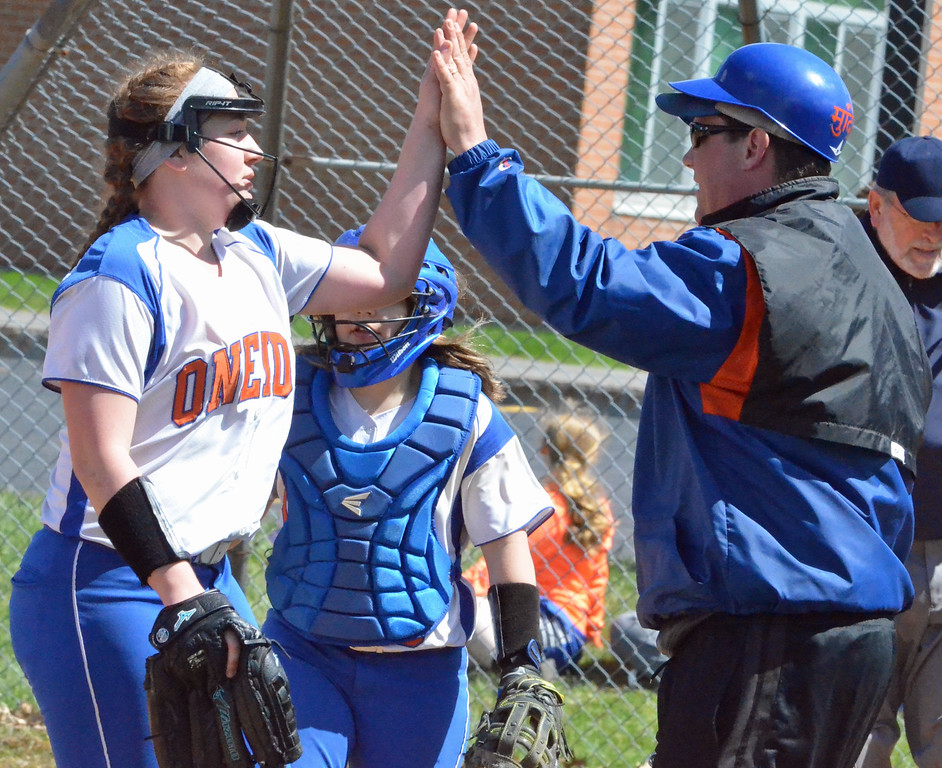 . KYLE MENNIG � ONEIDA DAILY DISPATCH Oneida coach Mike Curro, right, congratulates pitcher Kylie Chesebro after the seventh inning of a victory over Jamesville-DeWitt in Oneida on Monday, April 17, 2017.