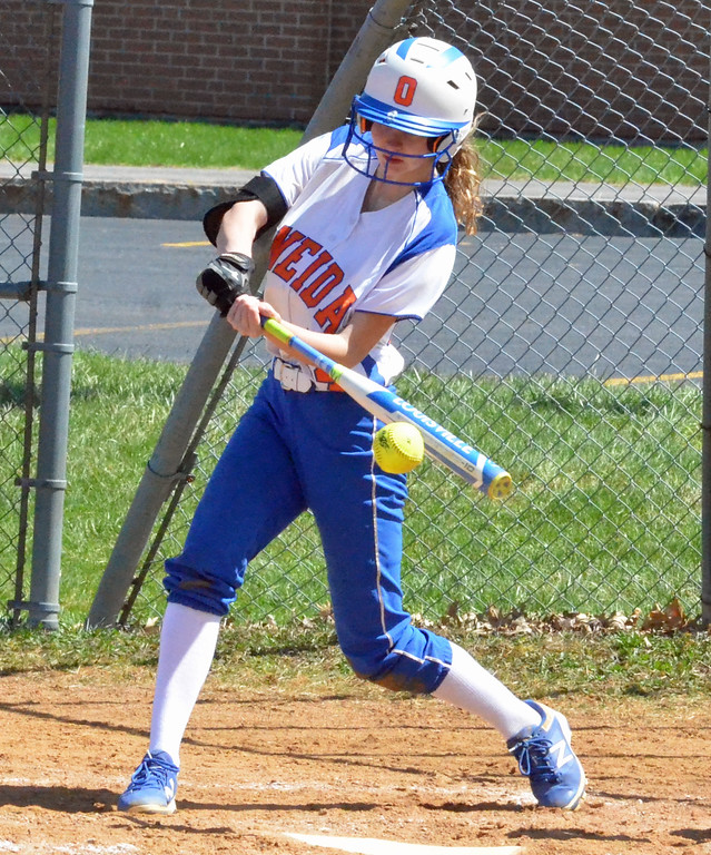 . KYLE MENNIG � ONEIDA DAILY DISPATCH Oneida\'s Lauren Skibitski (24) connects for a hit against Jamesville-DeWitt during their game in Oneida on Monday, April 17, 2017. Skibitski was called out on the play.