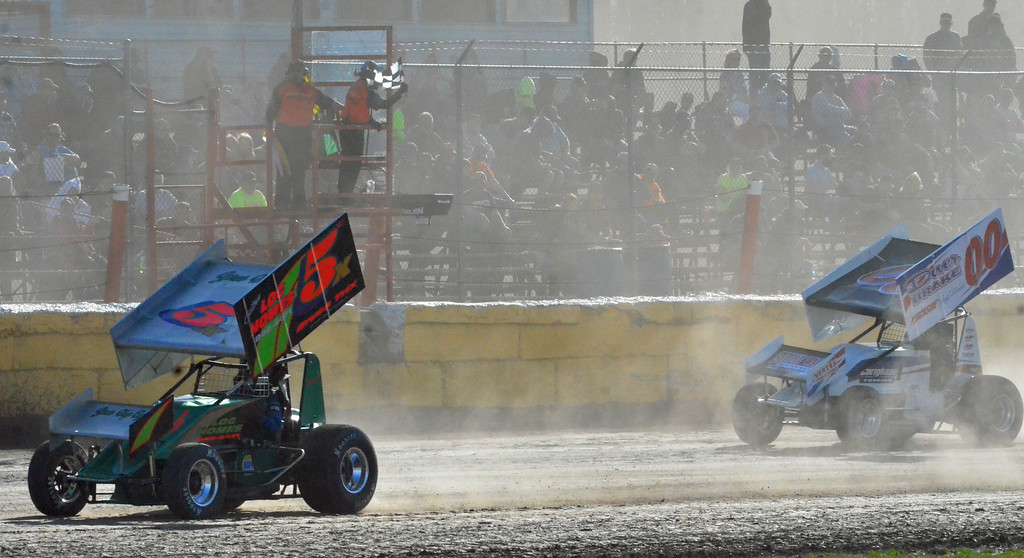 . JOHN BREWER � ONEIDA DAILY DISPATCH Drivers cross the finish line on opening day at Utica-Rome Speedway in Vernon on Sunday, April 23, 2017.
