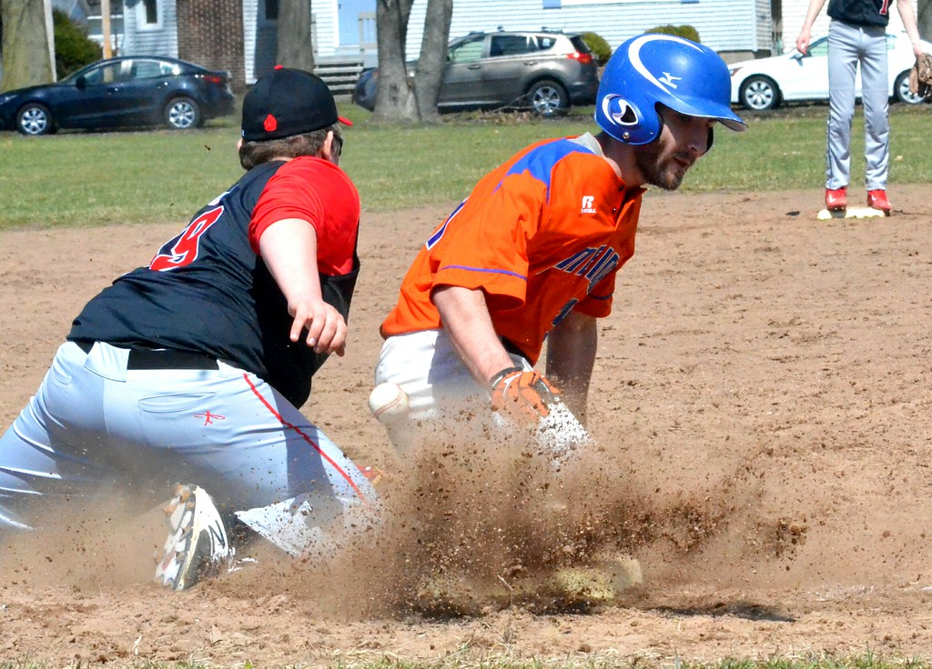 . KYLE MENNIG � ONEIDA DAILY DISPATCH Oneida�s James Dick (24) slides safely into third as the ball gets away from Chittenango�s Joseph Mosack (19) during their game in Rome on Sunday, April 9, 2017.