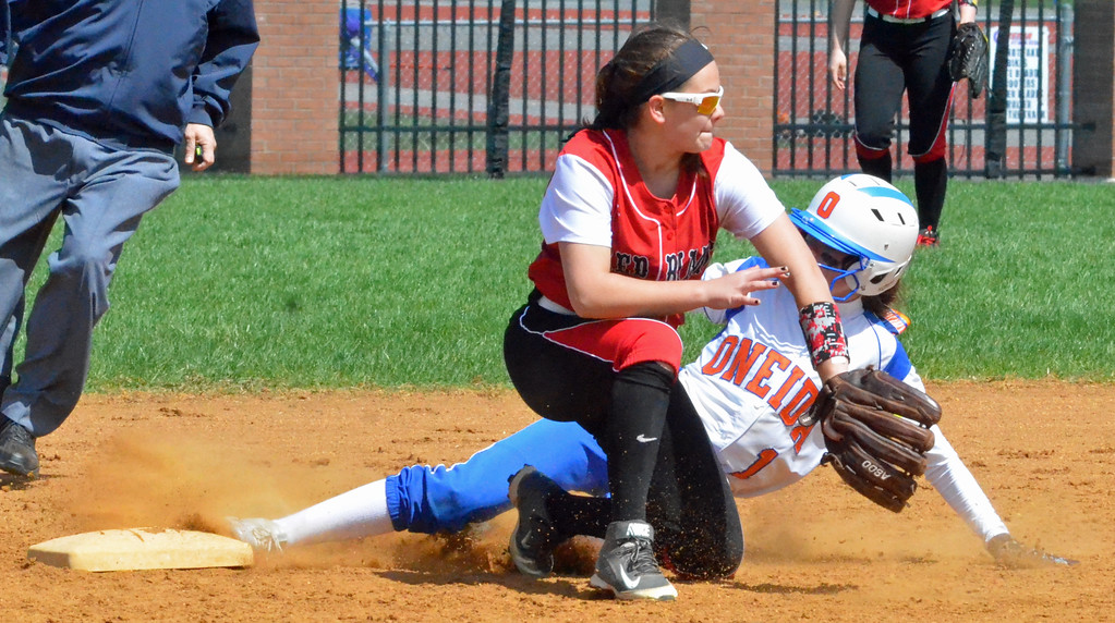 . KYLE MENNIG � ONEIDA DAILY DISPATCH Oneida\'s Kaylin Curro (1) slides into second for a stolen base as Jamesville-DeWitt\'s Makenzie Keeler (9) fields the throw during their game in Oneida on Monday, April 17, 2017.