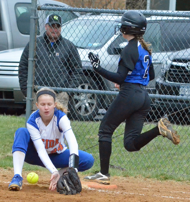 . KYLE MENNIG � ONEIDA DAILY DISPATCH Camden\'s Lily Sullivan (2) safely reaches first as Oneida\'s Lauren Skibitski (24) stops the throw during their game in Oneida on Wednesday, April 12, 2017.