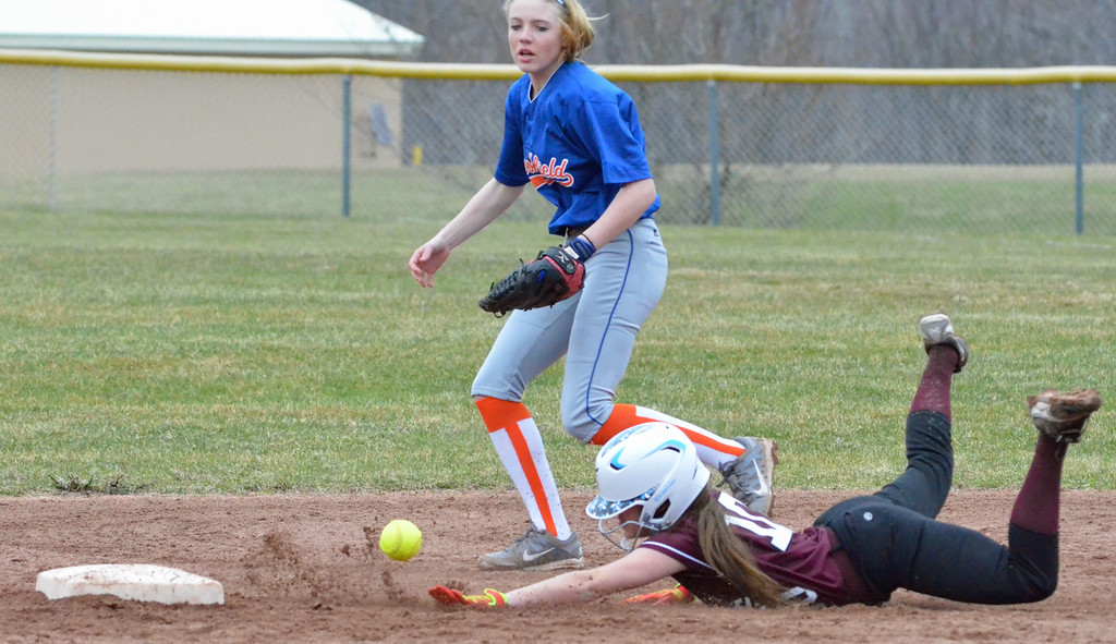 . KYLE MENNIG - ONEIDA DAILY DISPATCH Stockbridge Valley\'s Kendra Webb (10) dives safely into second as Brookfield\'s Jenna Bugbee (8) moves in to field the throw during their game in Munnsville on Wednesday, April 5, 2017.