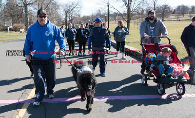 040217  Wesley Bunnell | Staff  Team Johnson Walk took place on Sunday April 2, 2017 in Walnut Hill Park. 100% of the proceeds collected are being donated to the Fight Colorectal Cancer Foundation. The walk was organized by Caroline Johnson, wife of New Britain Firefighter Scott Johnson, who is currently being treated for the disease. Firefighter Jeff Davis walks pyrenees dog Moose at the beginning of the walk.
