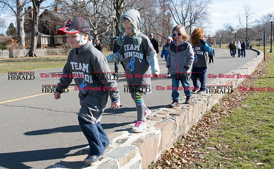 040217  Wesley Bunnell | Staff  Team Johnson Walk took place on Sunday April 2, 2017 in Walnut Hill Park. 100% of the proceeds collected are being donated to the Fight Colorectal Cancer Foundation. The walk was organized by Caroline Johnson, wife of New Britain Firefighter Scott Johnson, who is currently being treated for the disease. Kids walk down a low wall at the beginning of the event.