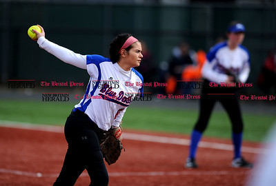 4/7/2017 Mike Orazzi | Staff Plainville's Kiya Broughton (6) while pitching against St. Paul Friday in Plainville.