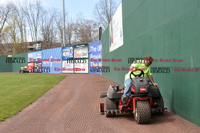 041017  Wesley Bunnell | Staff  Stadium preparation continues at the home of the New Britain Bees on Monday April 10.  Nick Tetro rides a tractor filling in low spots on the outfield warning track.