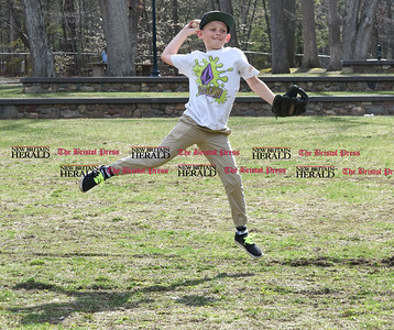 041017  Wesley Bunnell | Staff  Rockwell Park was packed with visitors eager to take advantage of the warm spring weather on Monday April 10. Memphis McConnell jumps and throws while playing catch with dad Michael.
