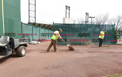 041017  Wesley Bunnell | Staff  Stadium preparation continues at the home of the New Britain Bees on Monday April 10.  Frank Fiordellesi, left, and John Wilczynski rake material into he warning track to fill un low spots.
