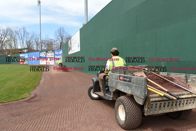 041017  Wesley Bunnell | Staff  Stadium preparation continues at the home of the New Britain Bees on Monday April 10.  Frank Fiordellisi drives down the warning track in right field filling in low spots with extra clay.