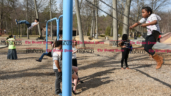 041017  Wesley Bunnell | Staff  Rockwell Park was packed with visitors eager to take advantage of the warm spring weather on Monday April 10. Rows of swing sets were filled with children enjoying the weather.
