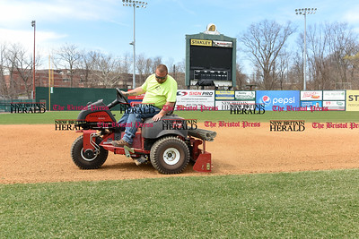 041017  Wesley Bunnell | Staff  Stadium preparation continues at the home of the New Britain Bees on Monday April 10.  Nick Tetro uses a riding tractor to help fill in low spots in the infield clay.