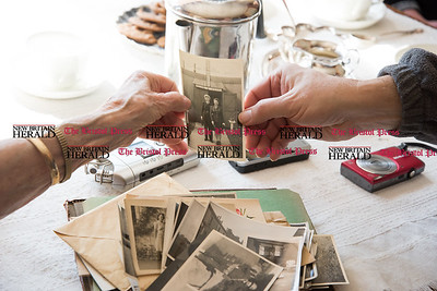 030617  Wesley Bunnell | Staff  Farmington resident Ola Ferla served as an Army Nurse during WWII in Scotland and England. Ola sorts through photos taken during the war.