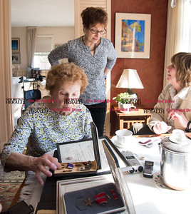 030617  Wesley Bunnell | Staff  Farmington resident Ola Ferla served as an Army Nurse during WWII in Scotland and England. Ola looks through commendation medals belonging to her late husband Joseph Ferla himself a WWII veteran.