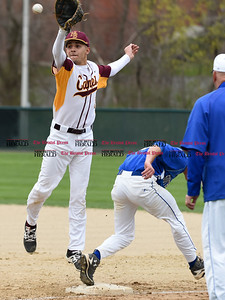 041917  Wesley Bunnell | Staff  New Britain High School baseball defeated Southington 7-5 on Wednesday afternoon. Guillermo Burgos (8) is unable to come up with the errant throw to first.