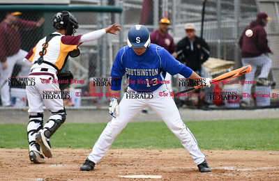 041917  Wesley Bunnell | Staff  New Britain High School baseball defeated Southington 7-5 on Wednesday afternoon. New Britain's catcher (3) tosses the ball back towards the mount after Brandon Kohl (13) stuck out looking to end the inning.