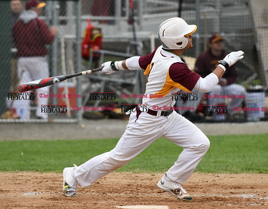 041917  Wesley Bunnell | Staff  New Britain High School baseball defeated Southington 7-5 on Wednesday afternoon. Danniel Rivera (1) puts the ball in play for a triple.