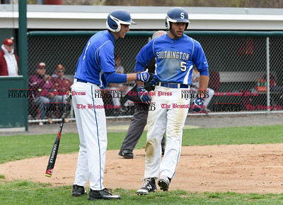 041917  Wesley Bunnell | Staff  New Britain High School baseball defeated Southington 7-5 on Wednesday afternoon. Tyler Cyr (5) congratulated by teammate after scoring a run.