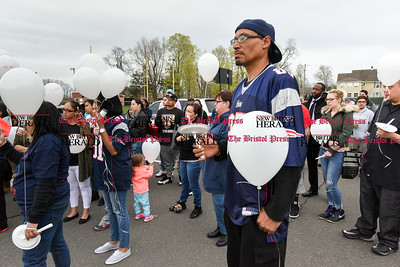 042417  Wesley Bunnell | Staff  A candlelight vigil was held at Casey Field in Bristol by family and friends of former New England Patriot Aaron Hernandez. Close family friend Everett Garcia stands with a balloon and candle during the ceremony.