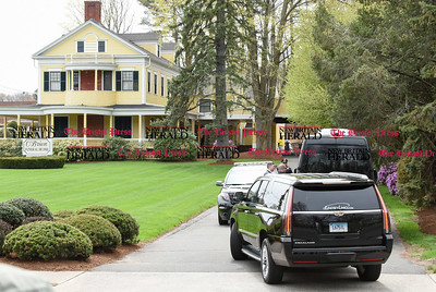 042417  Wesley Bunnell | Staff  A private limousine bus with family and friends of Aaron Hernandez enters the driveway of the O'Brien Funeral Home before the start of a private service on Monday April 24.