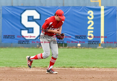 042417  Wesley Bunnell | Staff  Southington High School baseball defeated Berlin on Monday afternoon in a game played at Southington. Berlin second baseman Cody Lacasse (5) bobbles a ground ball but recovers for the out at first.