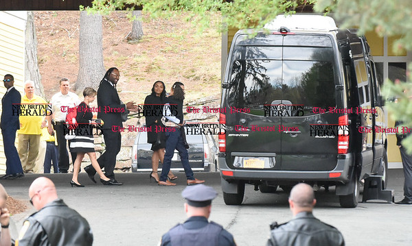042417  Wesley Bunnell | Staff  Free agent linebacker Brandon Spikes, middle, smiles at former New England Patriots Tight End Aaron Hernandez's daughter Avielle Janelle Hernandez as Hernandez's finance Shayanna Jenkins Hernandez looks on as they leave the O'Brien Funeral Home after a private service for Aaron Hernandez on Monday April 24.