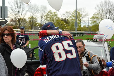 042417  Wesley Bunnell | Staff  A candlelight vigil was held at Casey Field in Bristol by family and friends of former New England Patriot Aaron Hernandez. Family friend Everett Garcia whose son was good friends with Aaron hugs Sarah Hernandez.