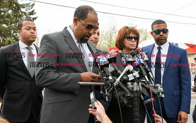 042417  Wesley Bunnell | Staff  Attorney for former New England Patriot Aaron Hernandez Ronald S. Sullivan Jr. , second rom left, reads a statement from the Hernandez family for the media outside O'Brien Funeral Home after a memorial service on Monday April 24.