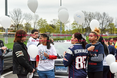 042417  Wesley Bunnell | Staff  A candlelight vigil was held at Casey Field in Bristol by family and friends of former New England Patriot Aaron Hernandez. Sarah Hernandez, second from the left stands with Christy Garcia wearing a Hernandez jersey.