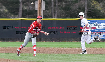 042417  Wesley Bunnell | Staff  Southington High School baseball defeated Berlin on Monday afternoon in a game played at Southington. Berlin's Cody Lacasse (5) fields and throws home for the force but the throw was off line.