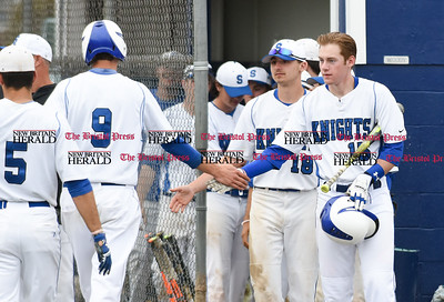 042417  Wesley Bunnell | Staff  Southington High School baseball defeated Berlin on Monday afternoon in a game played at Southington. Southington's Brayden Cooney (15) congratulates teammate Johnathan Mikosz (9) as he comes back to the dugout.