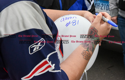 042417  Wesley Bunnell | Staff  A candlelight vigil was held at Casey Field in Bristol by family and friends of former New England Patriot Aaron Hernandez. Messages were written on balloons supporting the Hernandez family which were then released into the air.