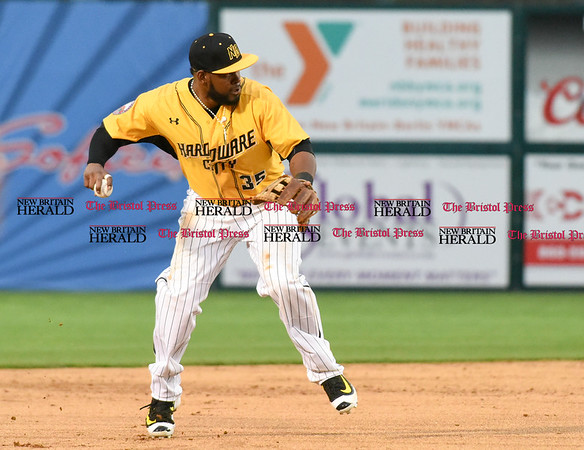 042717 Wesley Bunnell | Staff The New Britain Bees vs the Lancaster Barnstormers played on Thursday evening. Jovan Rosa (35) fields a ground ball glove side after his moment brings to the shortstop position.