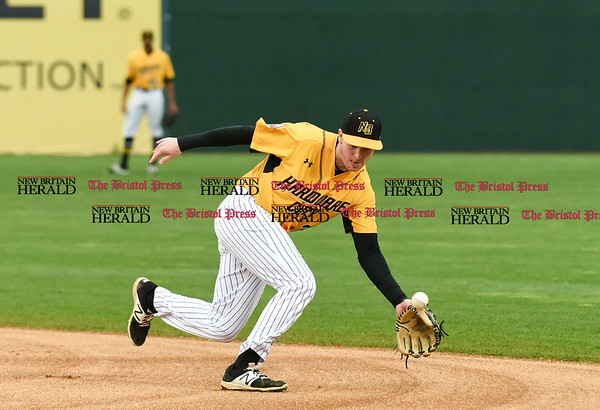 042717 Wesley Bunnell | Staff The New Britain Bees vs the Lancaster Barnstormers played on Thursday evening. A ground ball hops over the glove of Jake McGuiggan (2) .