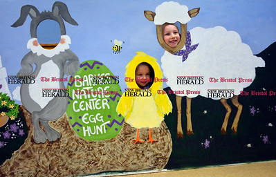 3/25/2016 Mike Orazzi | Staff Kailyn Agudelo and her sister Genna pose for a photograph while at the Barnes Nature Center for an egg hunt on Friday.