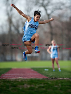 4/11/2017 Mike Orazzi | Staff Middletown's Jennifer Barber in the long jump Tuesday at Bristol Eastern.