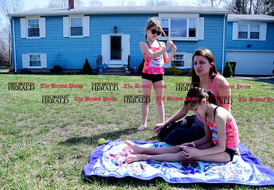 4/11/2017 Mike Orazzi | Staff Heather Pompei and her daughters Hannah, 7 1/2 and Mia, 9 1/2 enjoy warm temperatures and sunshine on Fleetwood Road in Southington Tuesday.