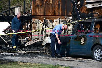 4/11/2017 Mike Orazzi | Staff Southington fire inspectors Bob Hunt and  Len Chozick survey the damage at a fire scene on Fleetwood Road in Southington.