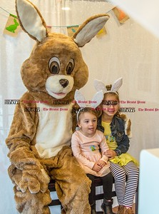 Stella Scalise, 2, center, and Natalia Prisco, 6, right, get their photo taken with the Easter Bunny at the New Britain Parks and Recreation Department's Breakfast with the Easter Bunny at The Back Nine restaurant at Stanley Golf Course in New Britain on Saturday, April 1, 2017. Over two hunderd people attended the two breakfast seatings. (Photo by Christopher Zajac)