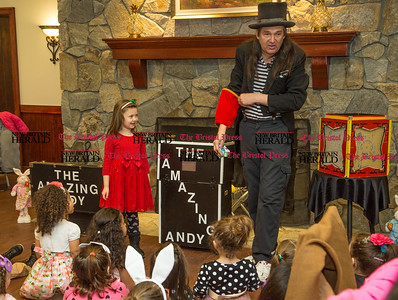 Isabella Sowinski, 5, is amused as she helps The Amazing Andy during one of his magic tricks at the New Britain Parks and Recreation Department's Breakfast with the Easter Bunny event held at The Back Nine restaurant at Stanley Golf Course in New Britain on Saturday morning, April 1, 2017. The kids were treated to photos with the Easter Bunny, gift baskets and a humorous magic show. (Photo by Christopher Zajac)