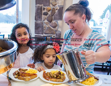 Amanda Turner, right, helps her daughter Aaliyh Turner, 6, and her friend Maliyah McKoy [cq], 5, get their breakfast at the New Britain Parks and Recreation Department's Breakfast with the Easter Bunny held at The Back Nine restaurant at Stanley Golf Course on April 1, 2017. (Photo by Christopher Zajac)